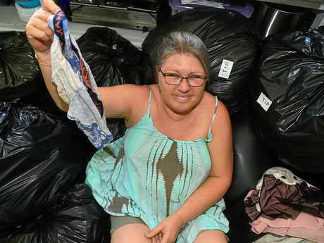 Judi Olsen of Mooloolah Valley Community Centre with bags of un-salvageable goods that people thoughtlessly dump.