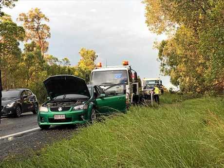 Emergency crews at a crash on the Bruce Hwy near Owanyilla.