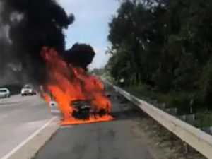 PEAK HOUR CHAOS: Car explodes into flames on SEQ highway