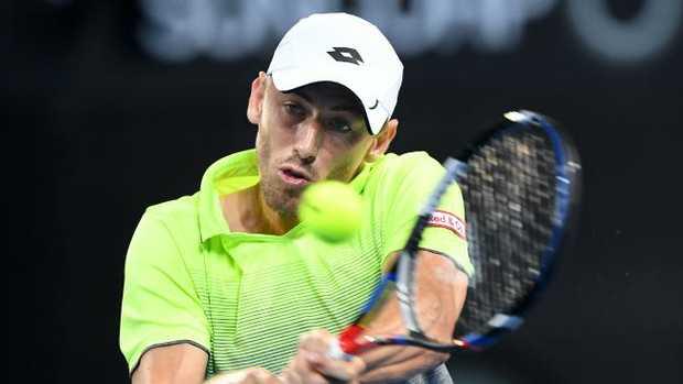 Australian John Millman returns during his first-round win over Peter Polansky.