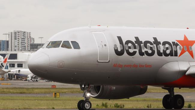 A Melbourne couple claim they were subjected to a barrage of homophobic slurs on a Jetstar flight.