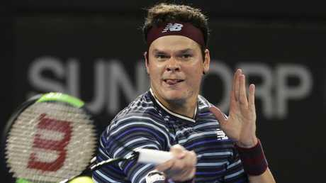 Milos Raonic hits a return to Alex De Minaur on Wednesday night.