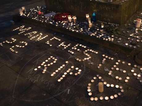 Memorial candles are seen during a vigil on St Ann's Square in Manchester, northwest England. Picture: AFP
