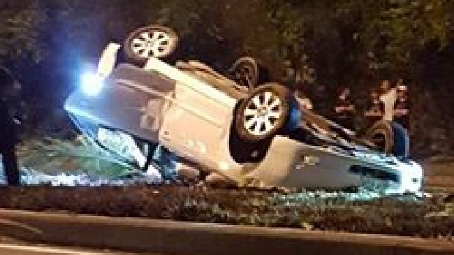 A car has overturned after speeding on Christine Ave at Varsity Lakes.