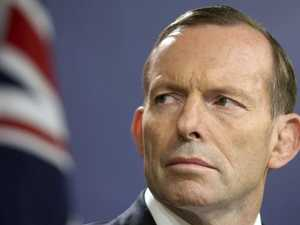 Abbott takes on PM over energy 'carbon tax'