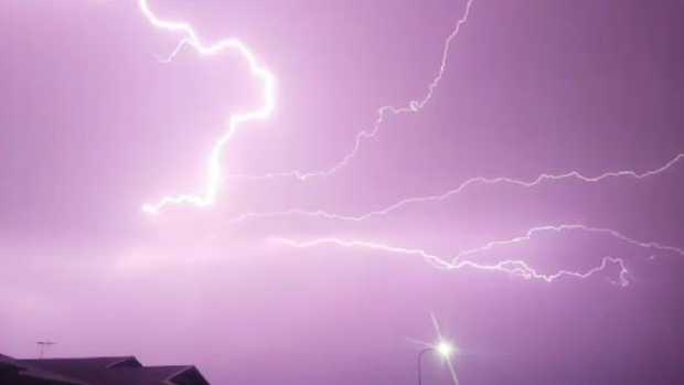 The storm which hit Townsville turned the sky an eerie purple colour. Photo Clinton Bradford