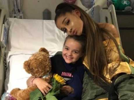 Ariana Grande visits with eight-year-old Lily Harrison a victim of the Manchester Arena bombing which left 22 people dead. Picture: Twitter