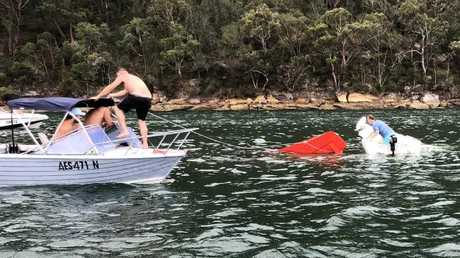 Kurt Bratby and others in a rescue attempt to save the people on board the seaplane that crashed into the Hawkesbury River killing all six. Picture: Caters News ATSB begins investigation into fatal Sydney seaplane crash