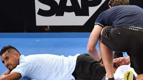 Nick Kyrgios receives treatment during his match against Matthew Ebden.