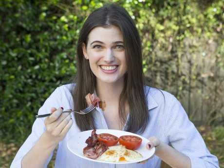 Kate Mottershead tucks into a brekkie of bacon and eggs. Picture: Sarah Matray