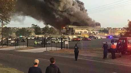 Staff and onlookers outside the Thomas Foods International's abattoir facility outside Murray Bridge. Picture: Facebook / Steven Pearson