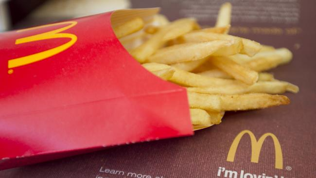 Eating Maccas fries after sex is one of the more bizarre ways women are using to help them conceive. Picture: Andrew Harrer/Bloomberg