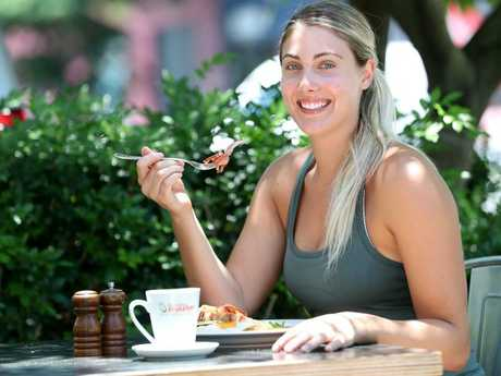 Karly Kallis enjoying a protein-filled bacon and eggs breakfast. Picture: Peter Wallis