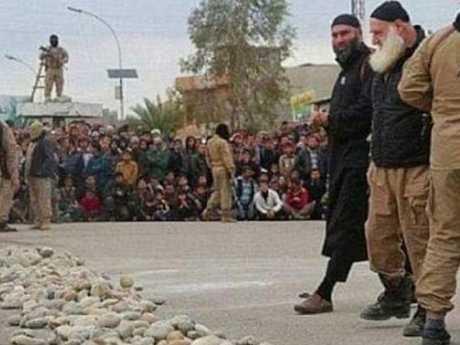 Abu Omer, aka White Beard, inspecting rocks ahead of a public stoning. Picture: ABNA 24