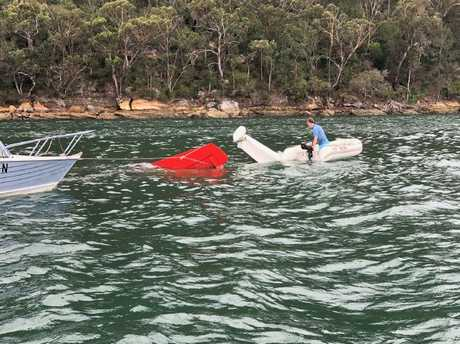 The attempted rescue effort carried out by Lachlan Hewitt, Kurt Bradbury and Will McGovern and Todd Sellars, who tried to pull the plane from the river with a rope. Picture: Todd Sellars