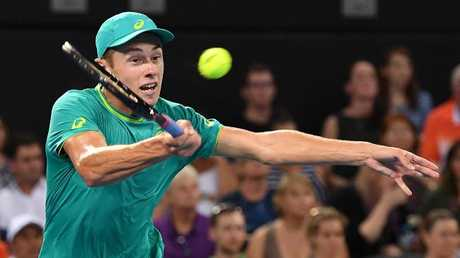 Alex De Minaur on his way to beating Milos Raonic on Wednesday night.