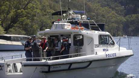 Police and Australian Transport Safety Bureau investigators depart on a police boat to go to the scene of a seaplane crash on the Hawkesbury River. Picture: AP Photo/Rick Rycroft