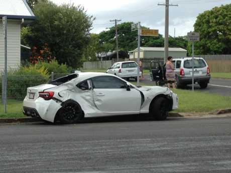 PURSUIT: The white Toyota 86 sports coupe used in a police chase from the Sunshine Coast to Maryborough. Two men were seen running from the scene after the car collided with a truck at the intersection of Russell and Edward Sts.