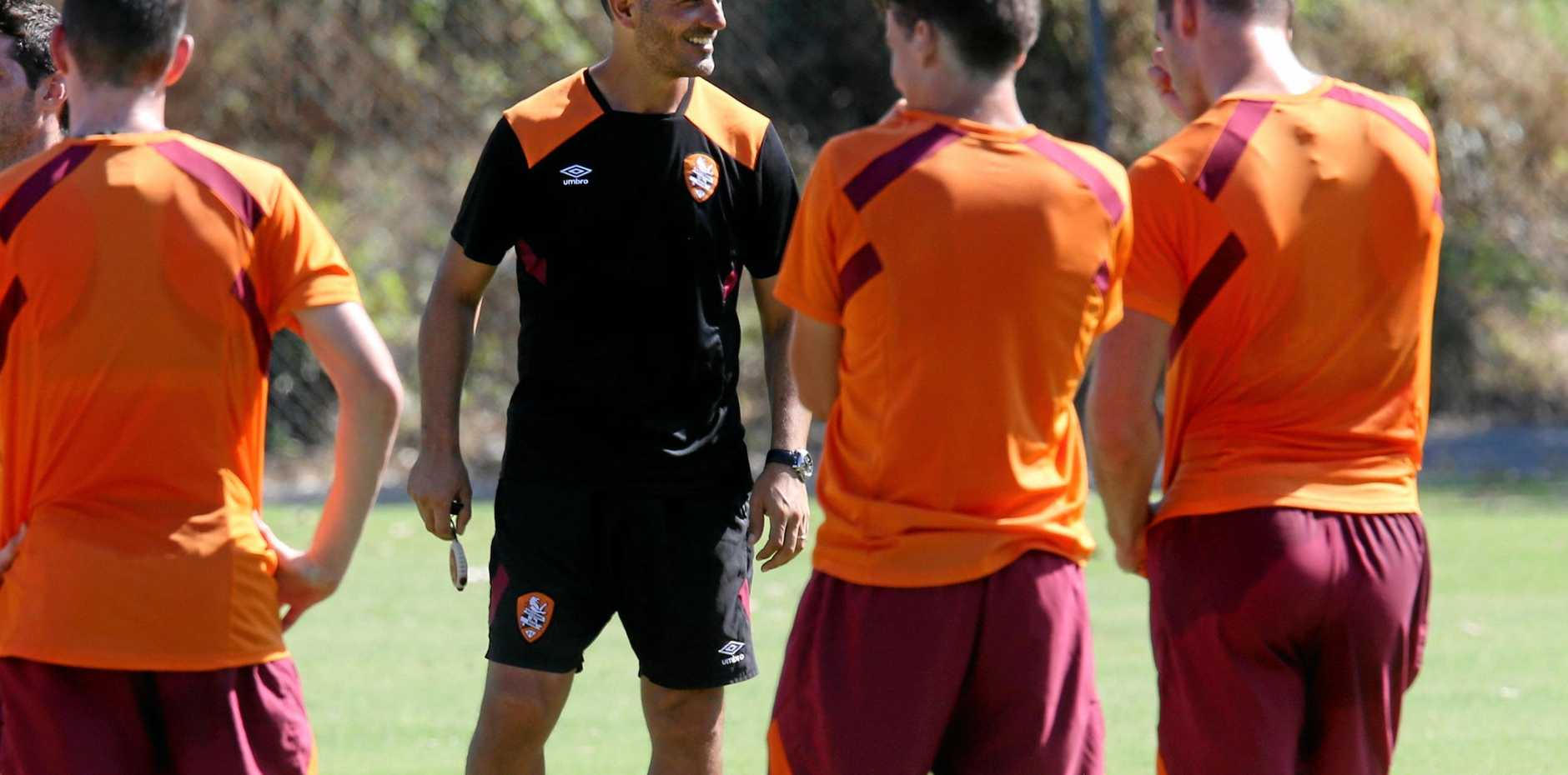 PREPARING: John Aloisi (centre) during a Brisbane Roar training session at Ballymore Stadium.