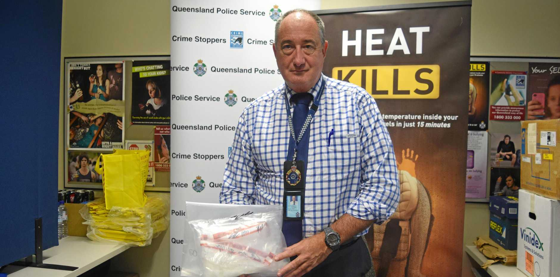 Mackay Poice Senior Sergeant David Tucker with a quantity of ice seized by police on Wednesday.