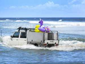 Driver bogged in surf