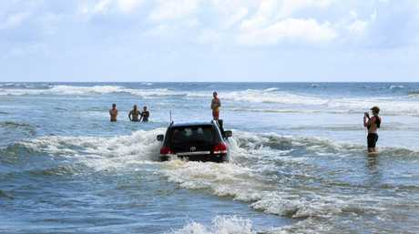 Police are shocked to see drivers repeatedly drive through water at Eli Creek, Fraser Island.