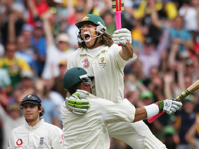Andrew Symonds celebrates his first Test century by leaping into the arms of Matthew Hayden.