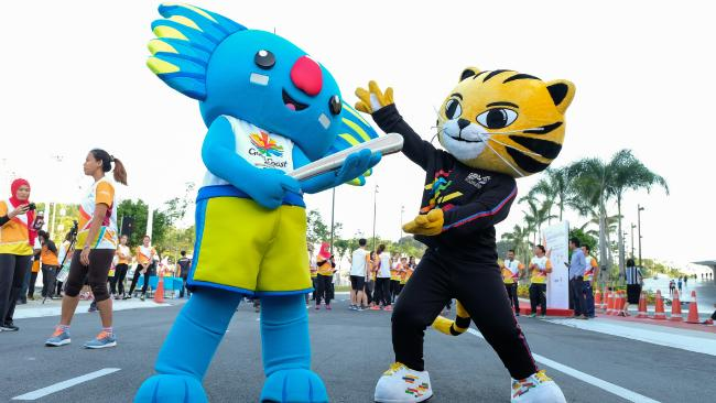 Games mascot Borobi catches up with South East Asian Games tiger mascot Rimau.