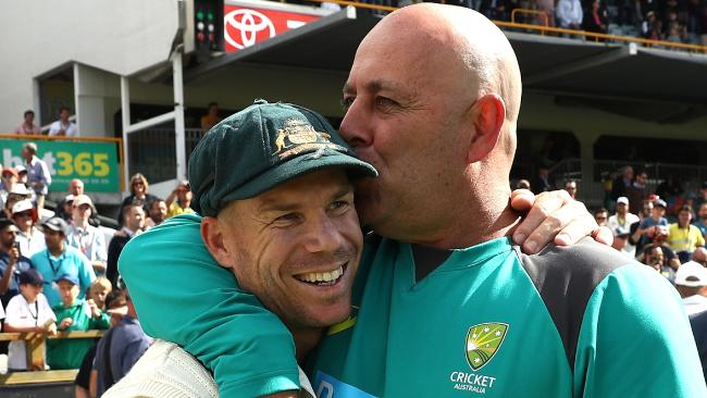 Darren Lehmann gives David Warner a kiss.