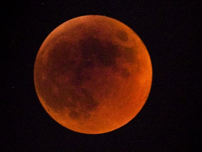 A total lunar eclipse, like this in 2011 seen over Israel, gives the moon a red colour. Picture: Uriel Sinai