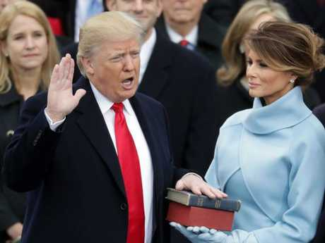 Donald Trump takes the oath of office as his wife Melania Trump holds the bible. Picture: Chip Somodevilla/Getty Images/AFP