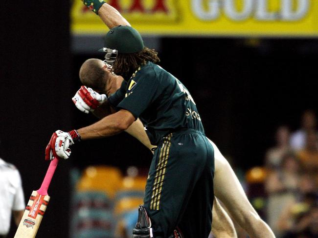 Andrew Symonds clashing with streaker Robert Ogilvie.
