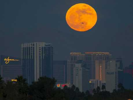 The first supermoon of the new year rises above the Vegas Strip on January 1. Picture: Richard Brian/Las Vegas Review-Journal