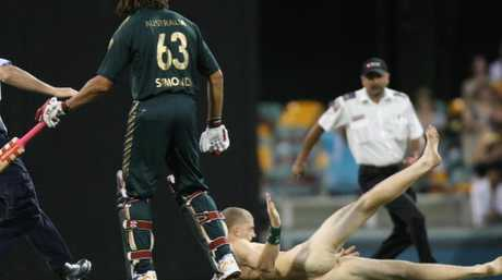 Andrew Symonds put the hip and shoulder in and dropped this streaker on his backside.