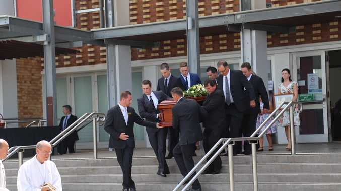 Son John Bjelke-Petersen carries Lady Flo's casket out of the funeral.