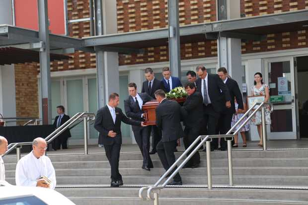 Son John Bjelke-Petersen carries Lady Flo's casket out of the funeral.