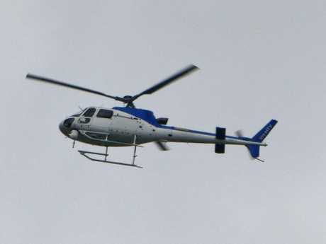 A media helicopter follows the unfolding car chase