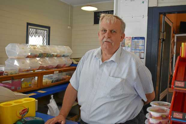 END OF AN ERA: Neil Fitzpatrick, owner of Murphy's Convenience Store, will be closing the doors on his store next Wednesday for the last time after 23 years. INSET: The sign out the front of the Caledonian Hill store.