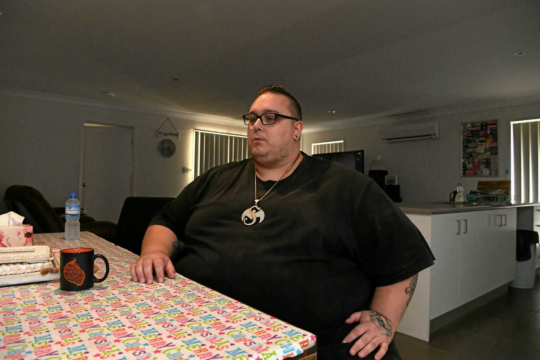 BIG TO BOSS: Chris Whiting with his wall of motivation is determined to lose 40kg to get below 200kg.
