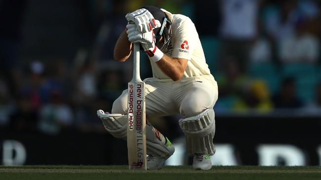 Joe Root slumps over his bat as he is caught for 83 at the SCG.