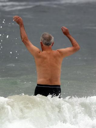 Prime Minister Malcolm Turnbull jumps over waves. Picture: Matrix