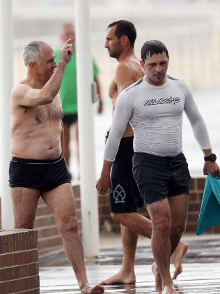 It appears that Prime Minister Malcolm Turnbull was recognised by bystanders during his dip. Picture: Matrix