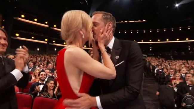 Nicole Kidman kisses Alexander Skarsgard on the lips after he won an Emmy. Picture: Supplied