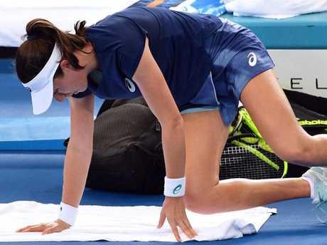 Johanna Konta receives medical assistance during a break against Elina Svitolina. Pic: AFP