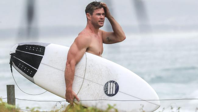 Chris Hemsworth taking a surf at Byron Bay before travelling to the United States. Picture: Media-Mode