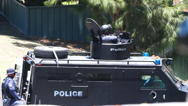 A BearCat armoured vehicle is also at the scene. Picture: Peter Lorimer.