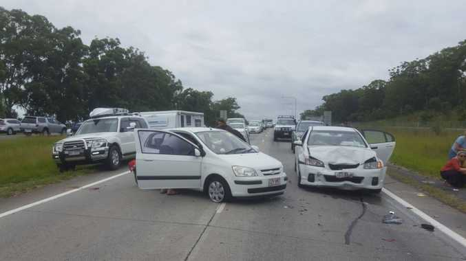 The scene of a two-vehicle crash on the Bruce Highway that left one patient trapped.