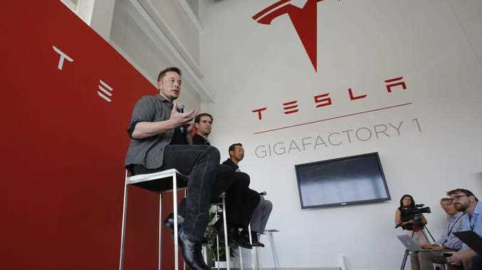 Elon Musk, CEO of Tesla Motors Inc., left, discusses the company's new Gigafactory in Sparks, Nev. Tesla Inc. chief executive Musk is on track to deliver on a promise by building the world'ss biggest lithium-ion battery in the Australian Outback within 100 days, an official said on Tuesday, Nov. 28, 2017.