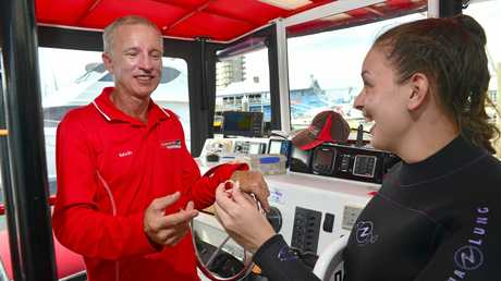 GREAT CATCH: Roxanne O'Donnell was diving with Scuba World and found the wedding ring that was lost by a German visitor. Skipper Kevin Lowndes is the brother in law of the German visitor.