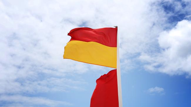 A red and yellow flag at a Gold Coast beach. Picture: Brendan Radke.